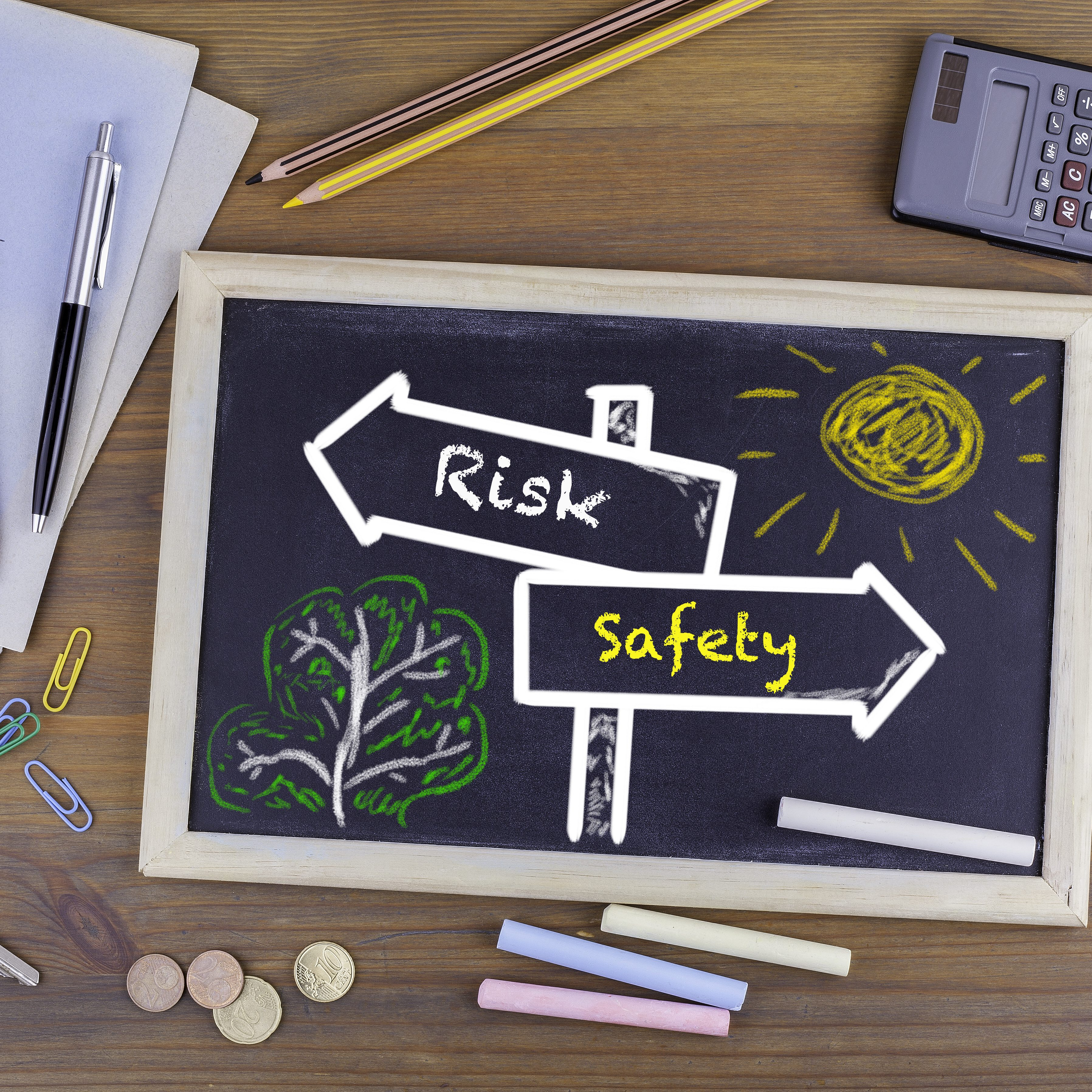 Risk, Safety signpost drawn on a blackboard